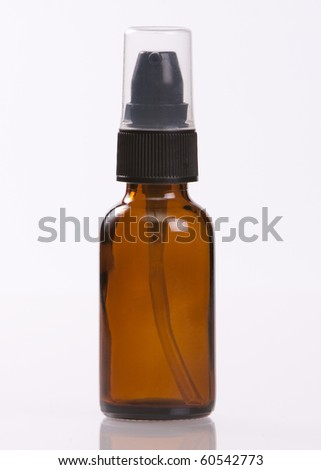 Empty brown glass jar with black pump and clear lid - stock photo