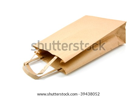 Empty brown paper shopping bag over white background