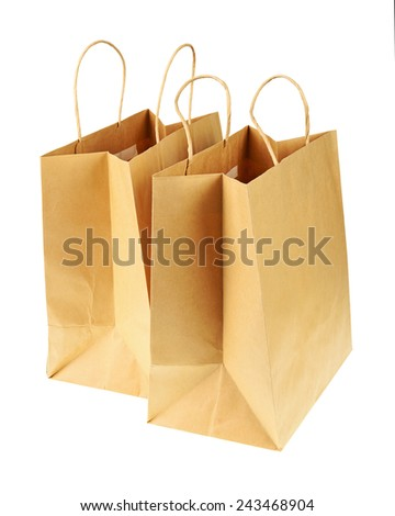 Empty brown recycled paper shopping bags isolated on white background. Side view from top. - stock photo