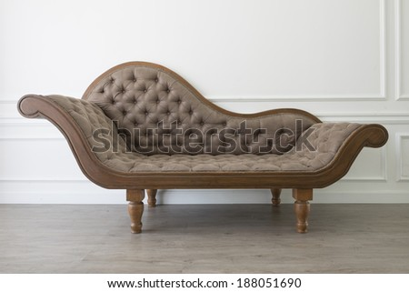 Empty brown vintage sofa - stock photo
