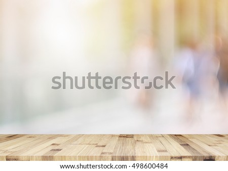 empty brown wooden table and office blur background with bokeh image, for product display montage