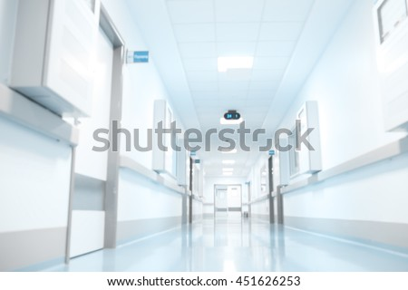 Empty building corridor, unfocused background.