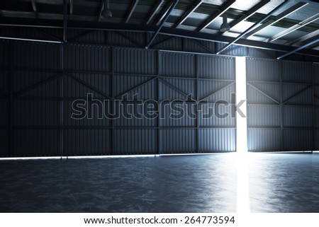 Empty building hanger with the door cracked open with room for text or copy space.Photo realistic rendering  - stock photo