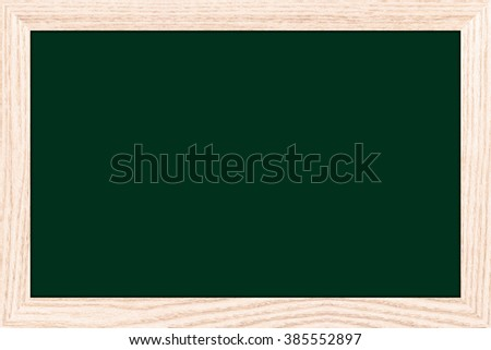 Empty bulletin board with a wooden frame. Chalkboard texture or chalkboard background for design with copy space for text or image.