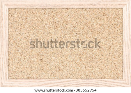 Empty bulletin board with a wooden frame. Cork board texture for design. Cork board background with copy space for text or image. - stock photo