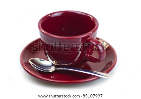 Empty Burgundy Coffee Cup with Chromed Spoon. Isolated White Background.