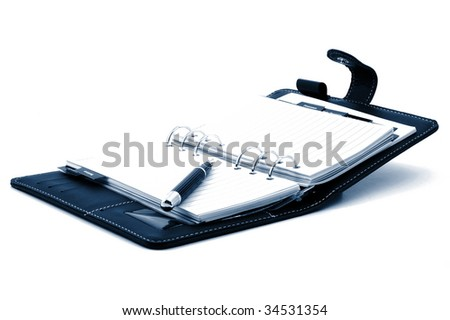 empty business notebook or organizer with pen - stock photo
