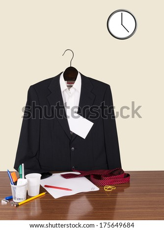 Empty business suit at desk. Resignation maybe. Blank envelope for your text. - stock photo