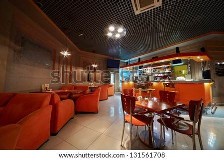 Empty cafe-bar in orange tones - stock photo