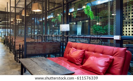 empty cafe interior coffee shop with a large sofaindoor decorate with table and bench - Large Cafe Interior