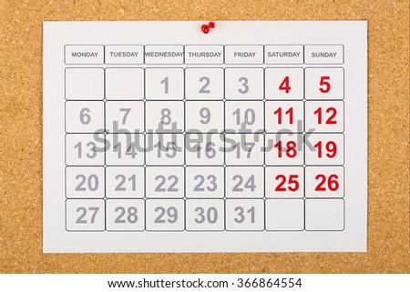 empty calendar pinned on corkboard - stock photo