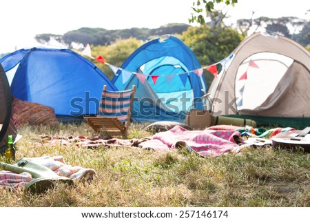 Empty campsite at music festival on a sunny day - stock photo