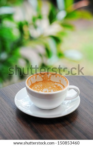 Empty cappuccino coffee cup. - stock photo