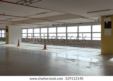 Empty car parking line  with red cone and white windows, can use as background - stock photo