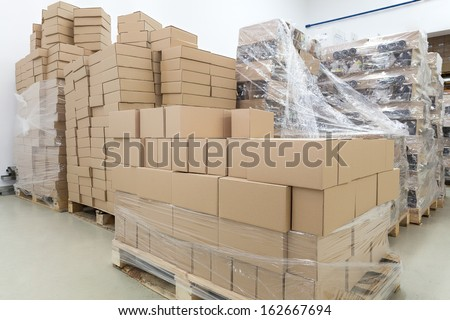 Empty cardboard boxes in a warehouse - stock photo