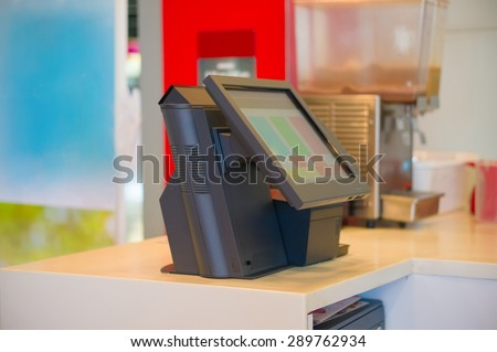 Empty cash desk terminal with computer touch screen in cafe