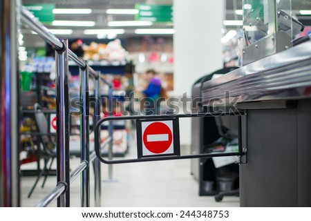Empty cash desk with closed way border in supermarket
