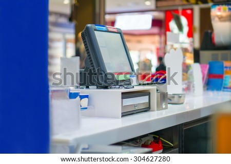 Empty cash desk with computer terminal in cafe - stock photo