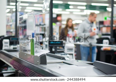 Empty cash desk with computer terminal in supermarket