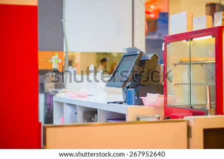 Empty cash desk with terminal in fast food restaurant in mall - stock photo