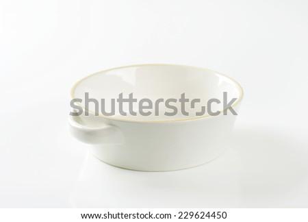 empty casserole dish on white background - stock photo