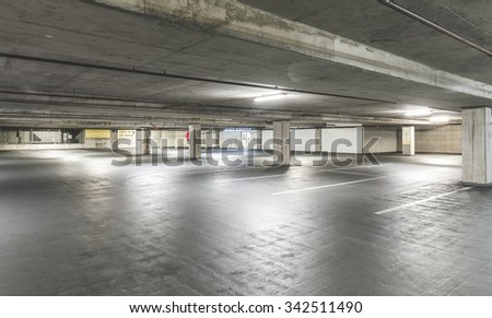 empty cement Parking Garage interior in the mall.