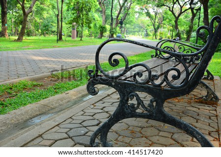 Empty chair in park feeling lonely