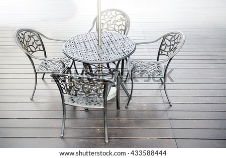 empty chairs and tables in outdoor area - stock photo