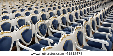 Empty chairs at cinema, opera or theater, blue tone and gold decorations - stock photo