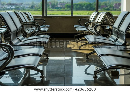 empty chairs for waiting boarding time in departure hall at the airport