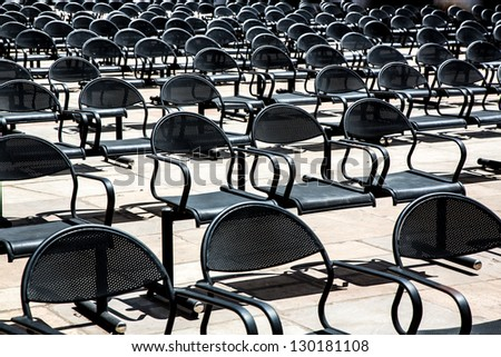 empty chairs standing in a row