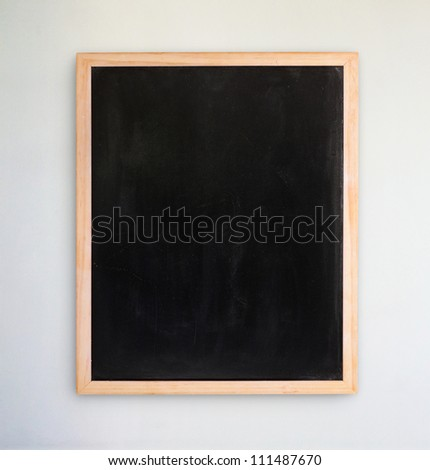 Empty chalkboard on the white  wall - stock photo