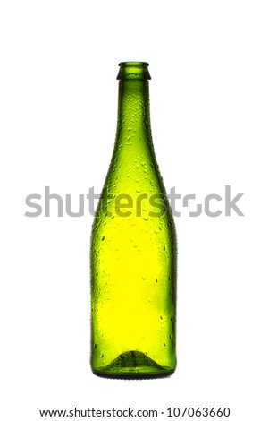 Empty champagne bottle, isolated on the white background, with water drops. - stock photo