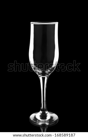 empty champagne glass isolated on black background