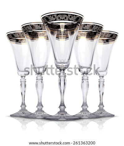 Empty champagne glasses on isolated white background - stock photo