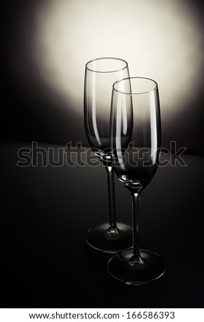 Empty champagne glasses on table