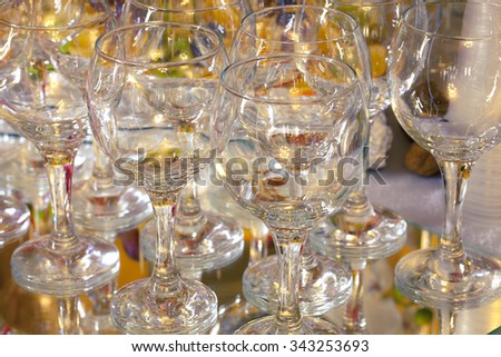 Empty champagne glasses on the mirror wedding table. Used as background.