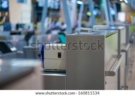 Empty check-in desks with computers in airport - stock photo