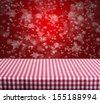 Empty checkered table and red winter background - stock photo