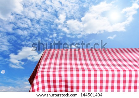 Empty checkered tabletop for product display montages - stock photo