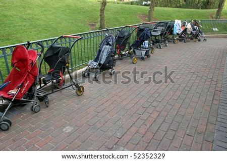 Empty children carriages at autumn park - stock photo