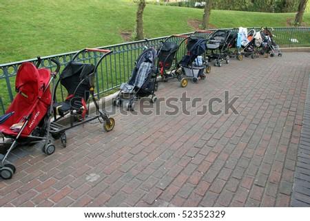 Empty children carriages at autumn park - stock photo
