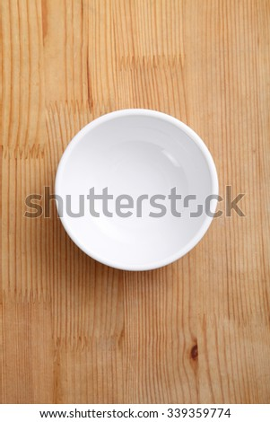 empty chinese rice bowl on a wooden background - stock photo