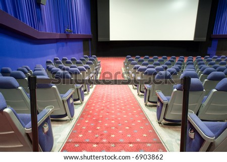 empty cinema auditorium with black cordon