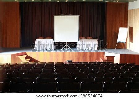 empty cinema or theater with projection screen canvas