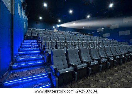 Empty cinema seat with blue environment - stock photo