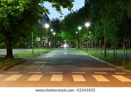Empty city road at night - stock photo