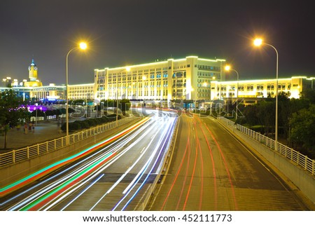 Empty City road surface floor car light trail with City building of night scene