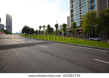 Empty City road surface floor with streetscape buildings