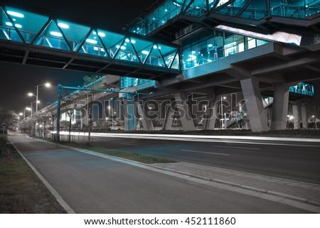 Empty City road surface floor with viaduct bridge of night scene - stock photo